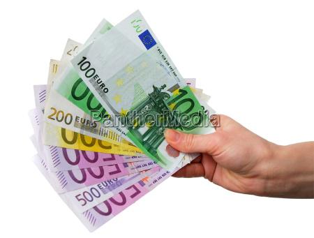 hand med euro regninger
