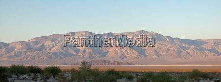 mountains desert wasteland sunset