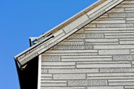 hus bygning facade byggematerialer klinker tagrende
