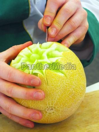 cantalupe melon og haender udskaering