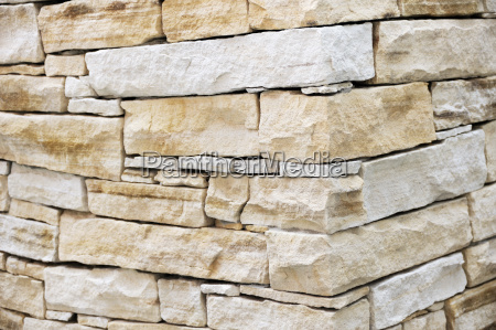vaeg lavet af sandsten mursten
