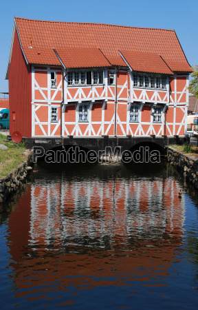 half timbered house with reflection