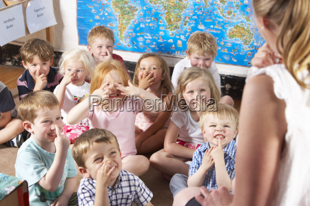 montessoripre school class listening to teacher