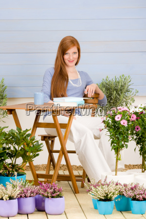 summer terrace redhead woman relax in