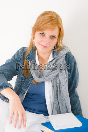 student young woman portrait with book