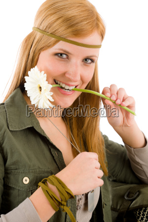 hippie young woman hold gerbera daisy