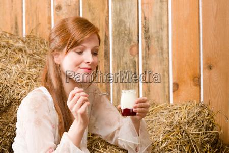 young healthy woman with natural yogurt