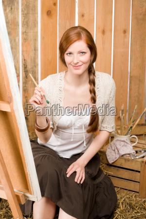 red hair romantic woman in barn