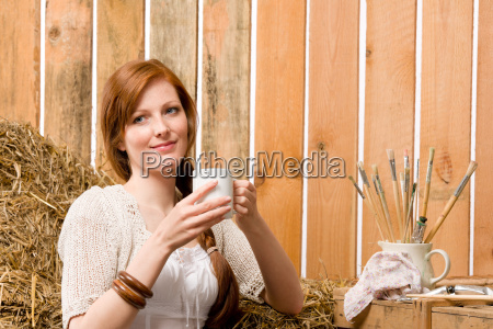 young romantic woman in barn holding