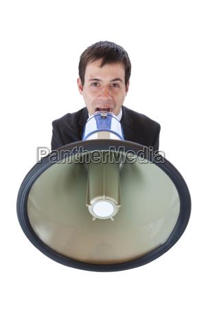 forretningsmand saelger brol meddelelse megafon raber