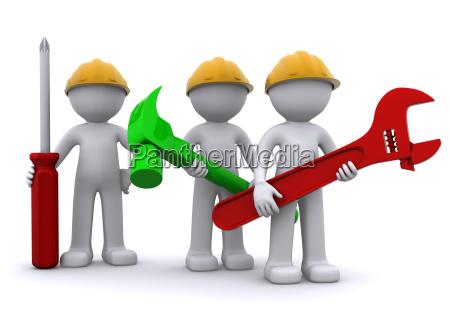 team af bygningsarbejder med udstyr