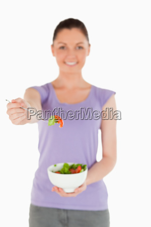 good looking woman holding a bowl