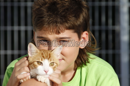 teenager with his cat