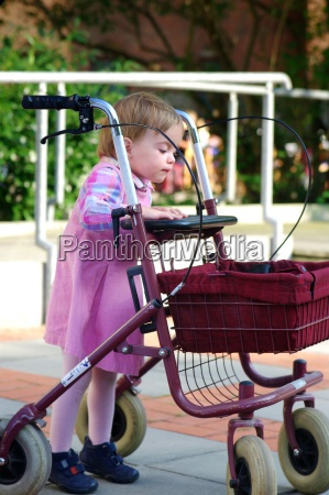 child playing with a walker