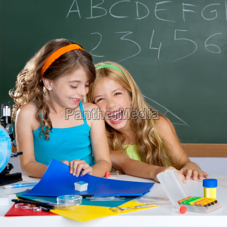 happy laughing kids student girls at