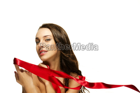 young woman holding red ribbon with