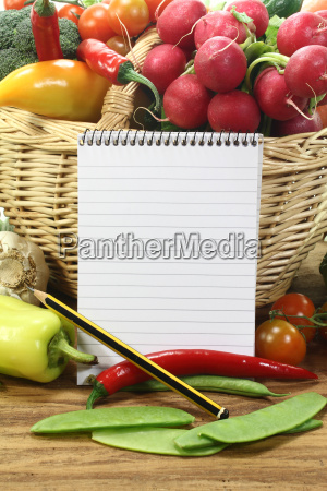 shopping list with fresh vegetables