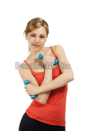 young fitness woman is holding dumbbells