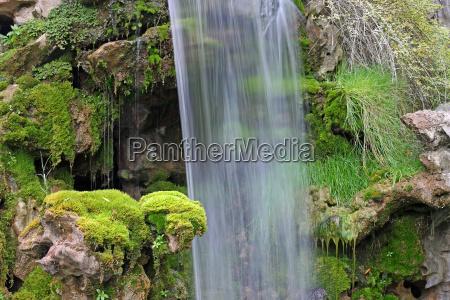 sten stenmasse stenlag klippe vandfald moss