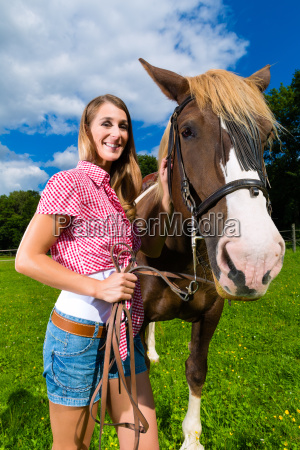 young woman on the meadow with