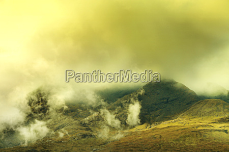 mystic landscape mountains with clouds