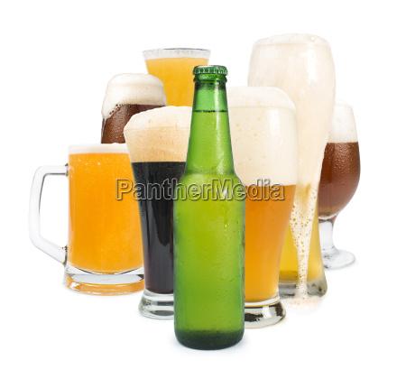 mug filled with beer and bottles
