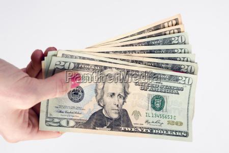 kvindelige hand besidder kontant betaling valuta