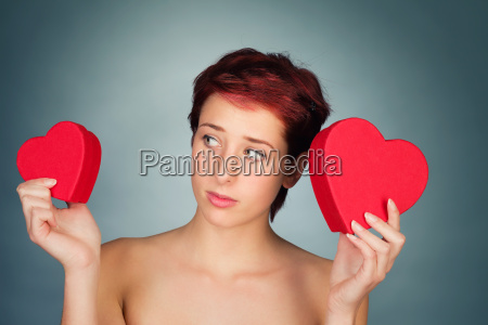 young woman chooses between two red