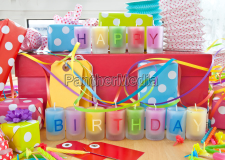 happy birthday candles and gifts