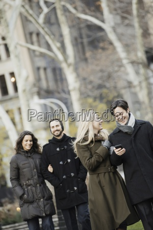 couple walking in urban park with