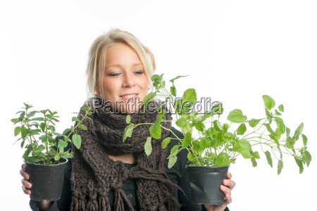 blonde woman with medicinal plants