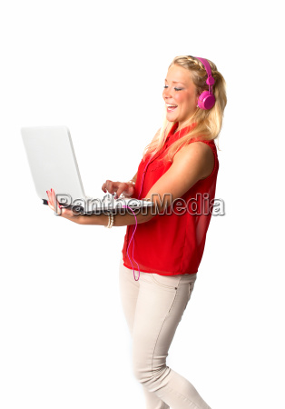 woman with headphones and laptop