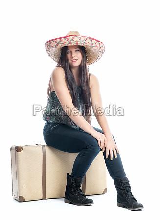 girl sitting on suitcase