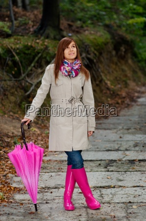 cute young woman with umbrella wearing