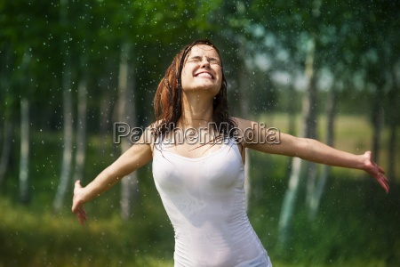 happy young woman enjoying in nature