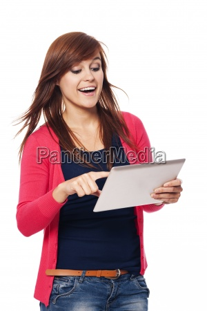 happy young woman using digital tablet