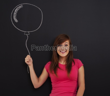 smiling woman holding in hand balloon