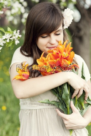 happy young woman enjoying the fragrance