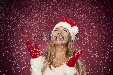 portrait of happy woman with snowflakes