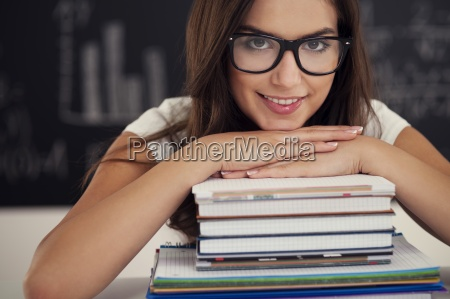 beautiful female student with books