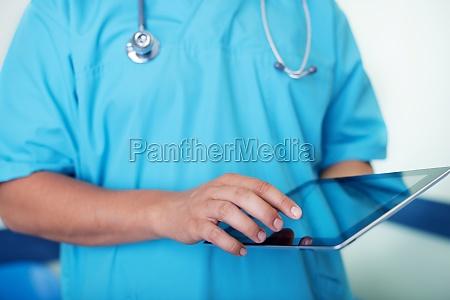 doctor working using digital tablet