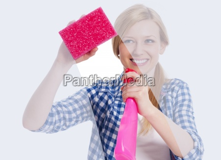 young woman standing behind window and