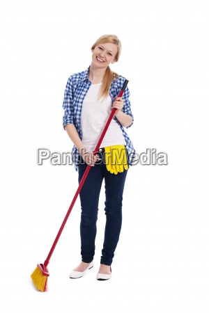 beautiful and smiling woman sweeping the