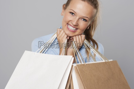 smiling blonde woman with eco shopping