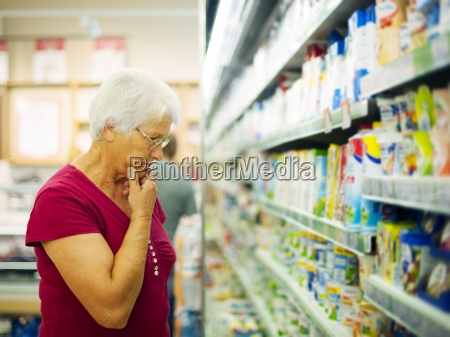 senior woman choosing a dairy products
