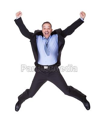 geschaeftsmann springt in freude