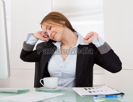 businesswoman stretching in office