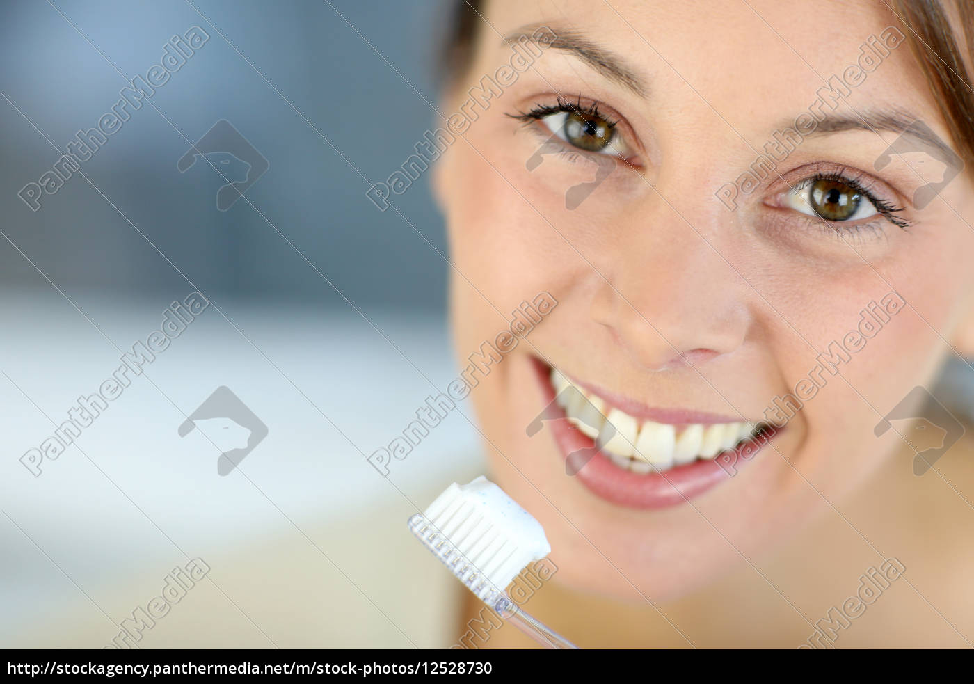 closeup, on, woman's, toothy, smile, brushing - 12528730