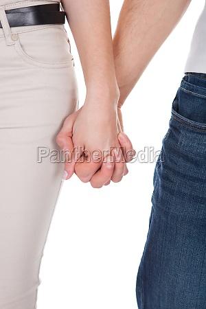 beskaret billede af par holde haender