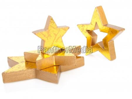 gyldne julestjerner isoleret pa hvid baggrund
